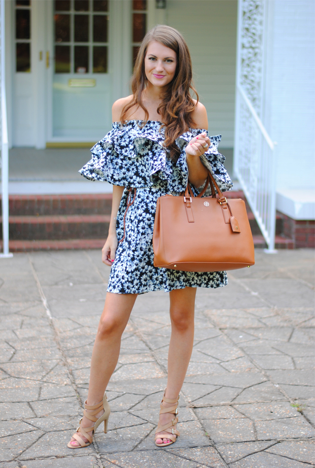 Daisy printed dress with Tory Burch bag