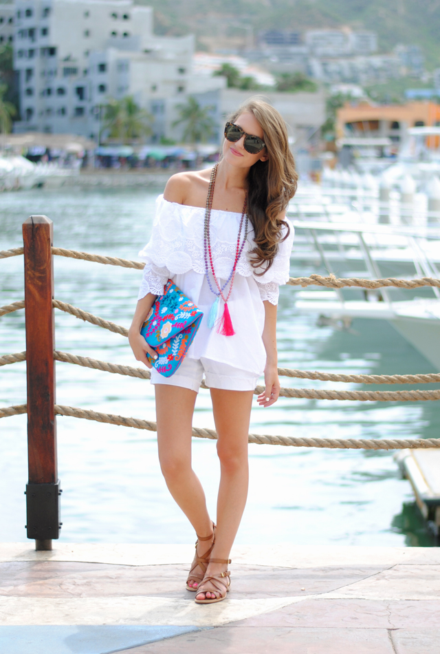 White on white with embroidered clutch