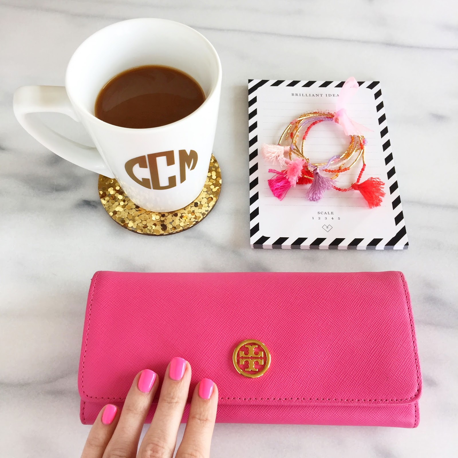 Tory Burch wallet.. and love the glitter coasters!
