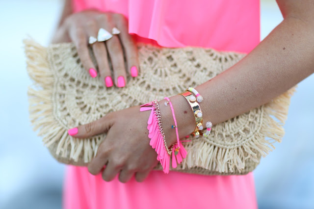 Neon pink bracelets and nails