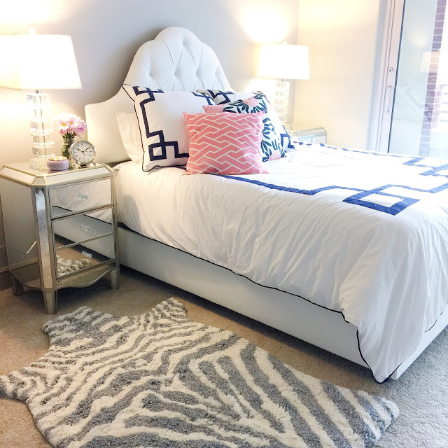 Love this bedroom decor, especially the zebra rug