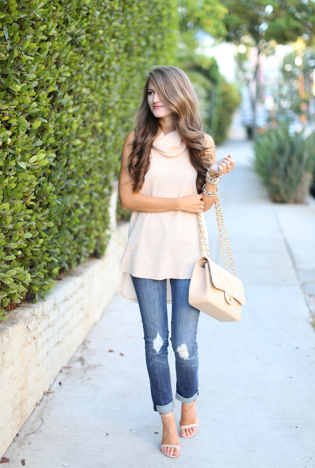 Camel colored sleeveless turtleneck sweater
