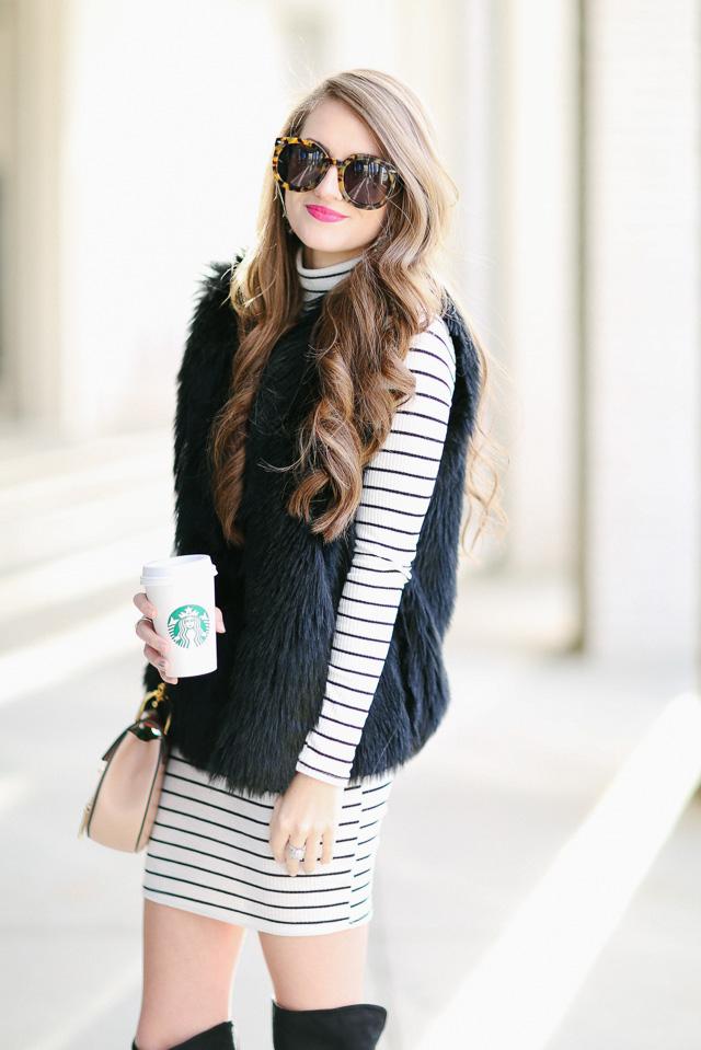 Love the black faux fur vest