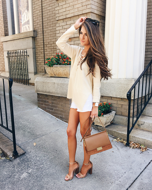 lace up sweater paired with shorts for summer/fall